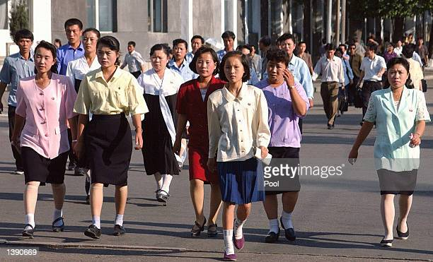 North Korean women walk towards a subway station after work September 16 2002 in Pyongyang North Korea The country recently hosted a historic visit...