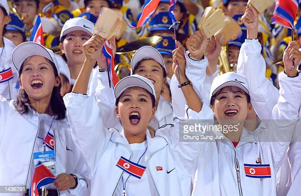 North Korean women wave North Korean national flags during a soccer match against Hong Kong at Changwon stadium September 28 2002 in Changwon South...
