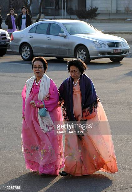 North Korean women wearing traditional dress arrive at the concert hall to watch New York Philharmonic orchestra led by Musical Director Lorin Maazel...