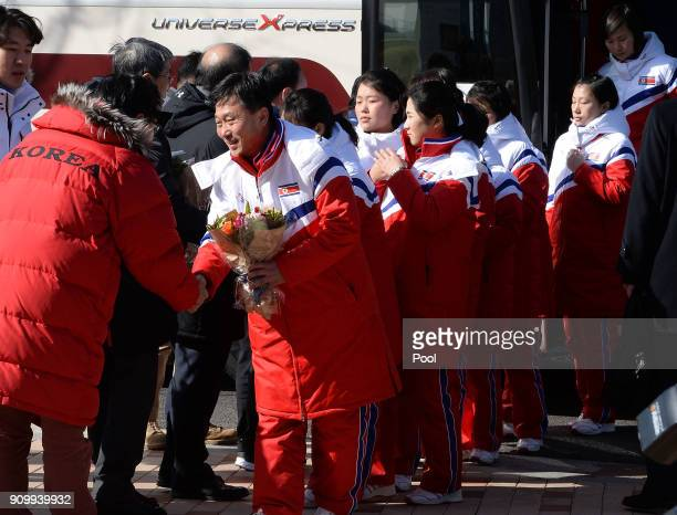 North Korean women's ice hockey players recieve flowers from South Korean players during a welcoming ceremony after arrive at South Korea's national...