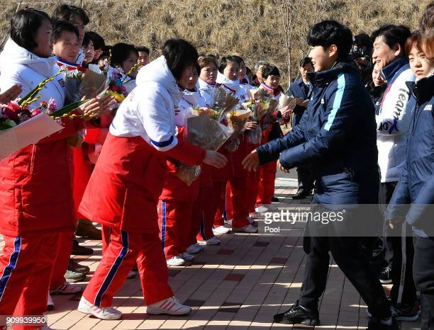 North Korean women's ice hockey players shakes hands with South Korean players during a welcoming ceremony after arrive at South Korea's national...