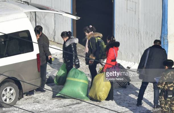 North Korean workers board a vehicle at customs in Dandong China's border city with North Korea on Jan 9 2018 They were returning to North Korea...