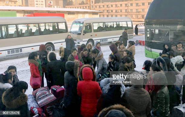 North Korean workers gather at customs in Dandong China's border city with North Korea on Jan 9 2018 They were returning to North Korea following...