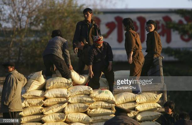 North Korean workers load goods on a truck on the bank of the Yalu River in the North Korean border city of Sinuiju on October 20 2006 in this...