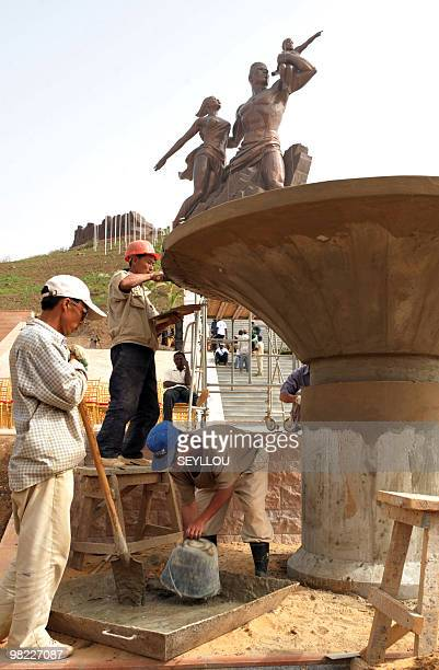 North Korean workers prepare the unveiling of the 'African Renaissance Monument' on April 2 2010 in Dakar for the April 3 inauguration where some 30...