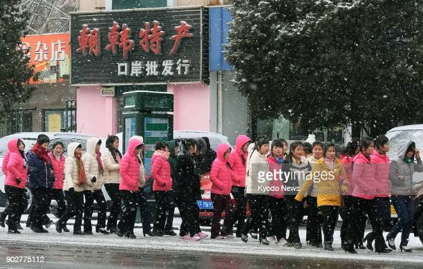 North Korean workers walk along a street near a custom office in Dandong a Chinese border city with North Korea on Jan 8 2018 Many North Korean...