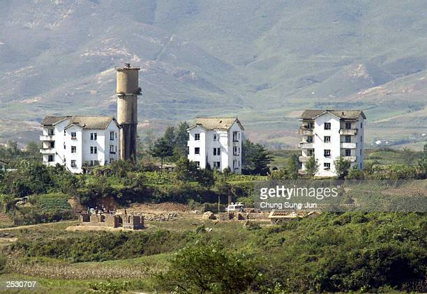 North Korean workers work in North Korea's propaganda village of Gijungdong are seen from South Korea's observation post in demilitarized zone on...