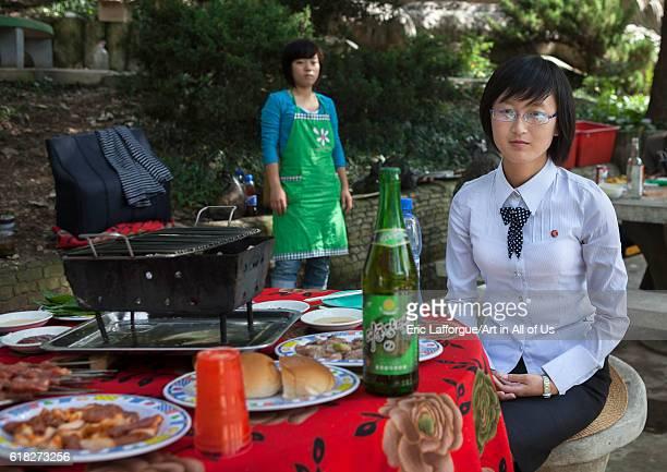 North korean young woman having picnic in a park pyongyang North Korea on September 14 2012 in Pyongyang North Korea