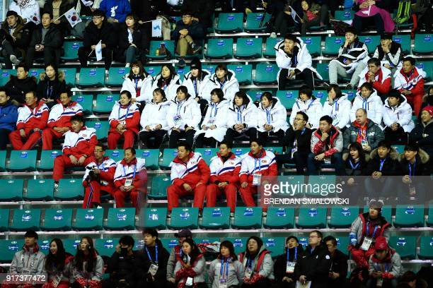 North Koreans and other spectators watch the women's preliminary round ice hockey match between Sweden and Unified Korea during the Pyeongchang 2018...