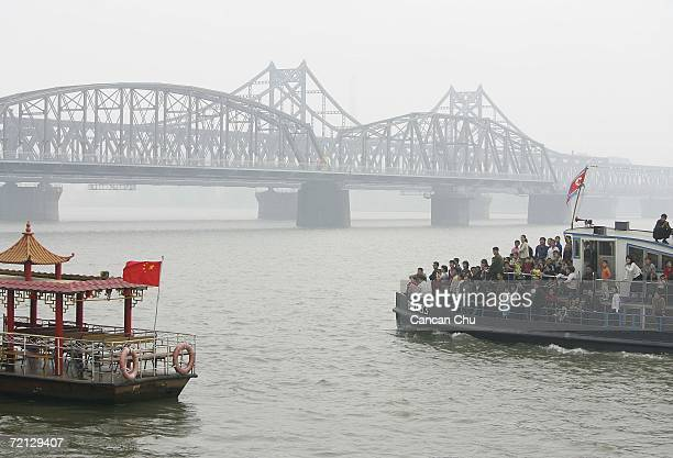 North Koreans from the border city of Sinuiju take part in a cruise on the Yalu River, next to the 'Broken Bridge' and the China-Korea Friendship...