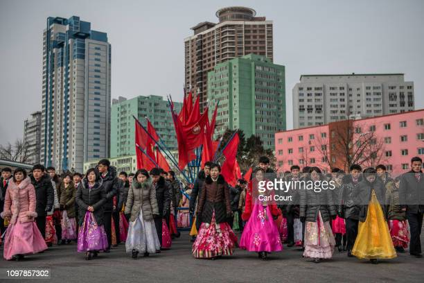 North Koreans including women in traditional Korean hanbok dresses prepare to take part in a mass dance to mark the 71st anniversary of the Korean...