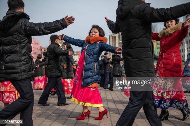 North Koreans including women in traditional Korean hanbok dresses take part in a mass dance to mark the 71st anniversary of the Korean Peoples Army...