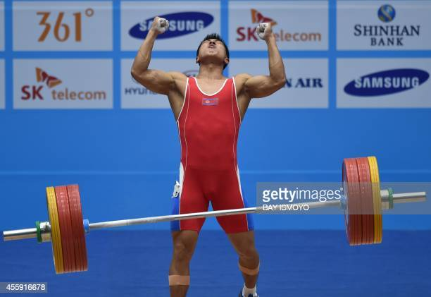 North Korean's Kim MyongHyok after completing a lift in the men's 69kg group A category at the Moonlight Festival Garden Weightlifting Venue during...