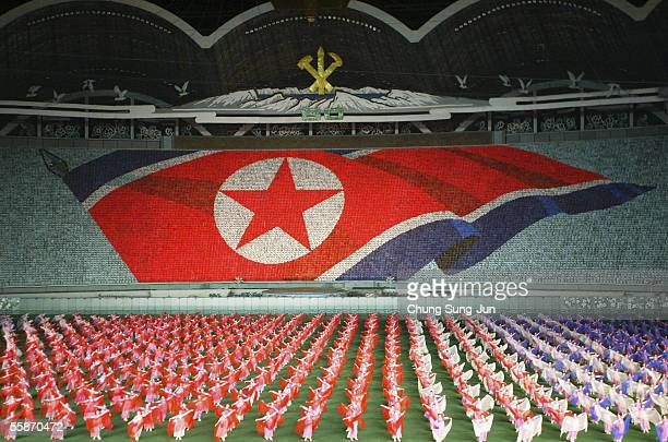 North Koreans perform showing North Korean national flag during the Arirang festival which is a part of commemorations marking the 60th anniversary...