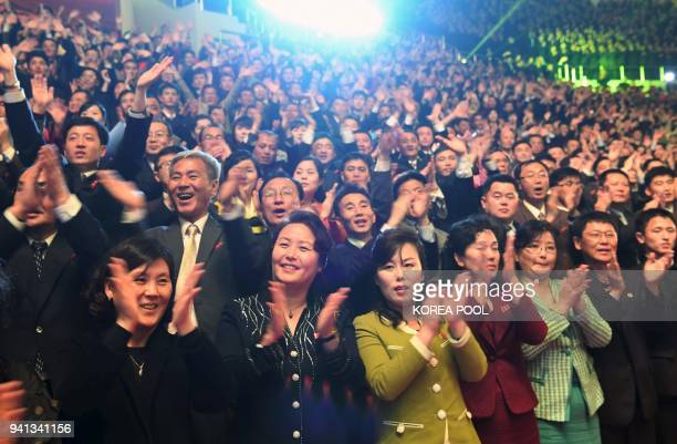 TOPSHOT North Koreans react as they watch a joint performance by South and North Korean musicians at the 12000seat Ryugyong Jong Ju Yong Gymnasium in...
