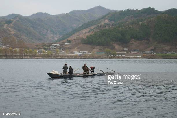 North Koreans ride boats in Yalu River, the border river shared with China, in Qingcheng, North Korea as seen from across the border on April 29,...