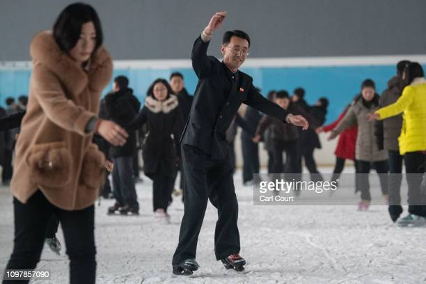 North Koreans skate at an ice skating rink on February 06 2019 in Pyongyang North Korea US President Donald Trump and North Korean Supreme Leader Kim...