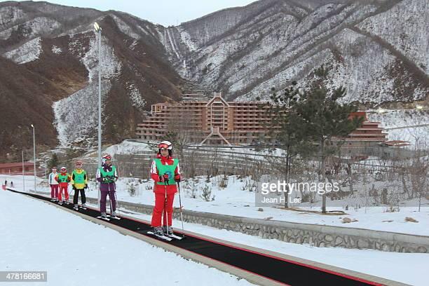 North Koreans take a ski lesson at the new Masik Ski Resort January 29 2014 near Wonsan in northeastern North Korea The resort reportedly boasts a...