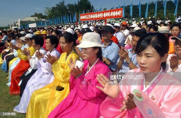 North Koreans welcome South Korean visitors in Pyongyang 15 August 2003 Civic representatives of North and South Korea began a fourday joint festival...