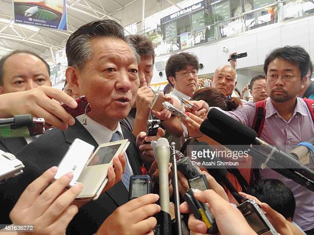 North Korea's ambassador for normalizing relations with Japan Song Il Ho is surrounded by media reporters at Beijing International Airport on July 3...