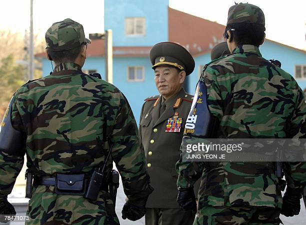 North Korea's chief delegate Kim YongChol walks by South Korean soldiers after the interKorean general talks at the south side of the truce village...
