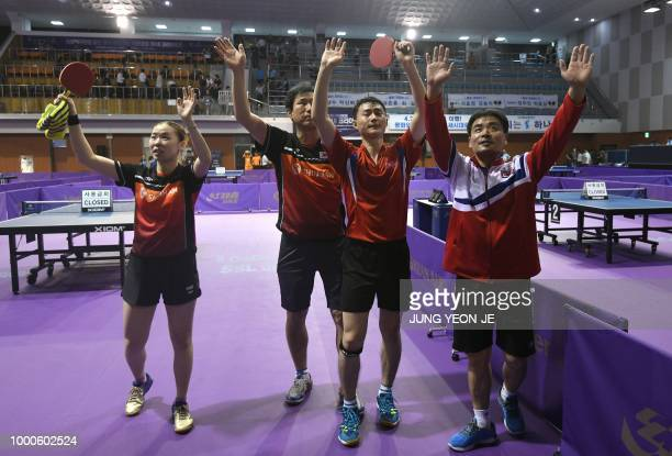 North Korea's Choe Il his partner South Korea's Yoo Eunchong and their coaches celebrate their victory against Spain's Alvaro Robles and Galia Dvorak...