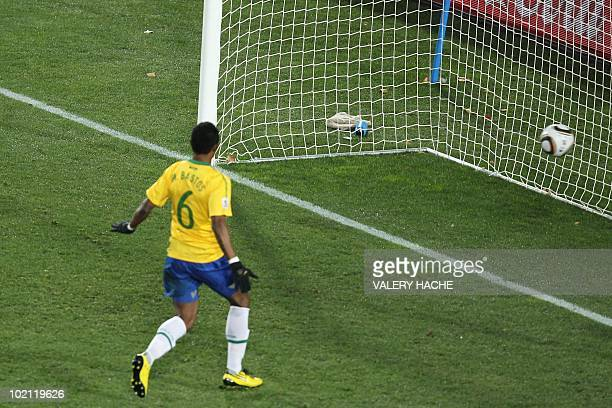 North Korea's defender Ji YunNam scores past Brazil's defender Michel Bastos during the Group G first round 2010 World Cup football match Brazil vs...