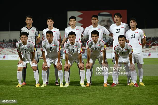 North korea's football players pose for a picture during the 2018 FIFA World Cup qualifying football match between Bahrain and North Korea at the...