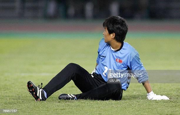 North Korea's goalkeeper Jon Myong Hui looks on after Germany's Renate Lingor scored a goal during the quarterfinal of the FIFA Women's Football...
