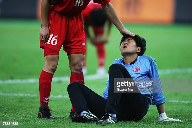 North Korea's goalkeeper Jon Myonghui is consoled by a teammate during the FIFA Women's World Cup 2007 Group B match against Sweden at the Tianjin...