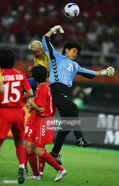 North Korea's goalkeeper Jon Myonghui punches the ball during the FIFA Women's World Cup 2007 Group B match against Sweden at the Tianjin Olympic...