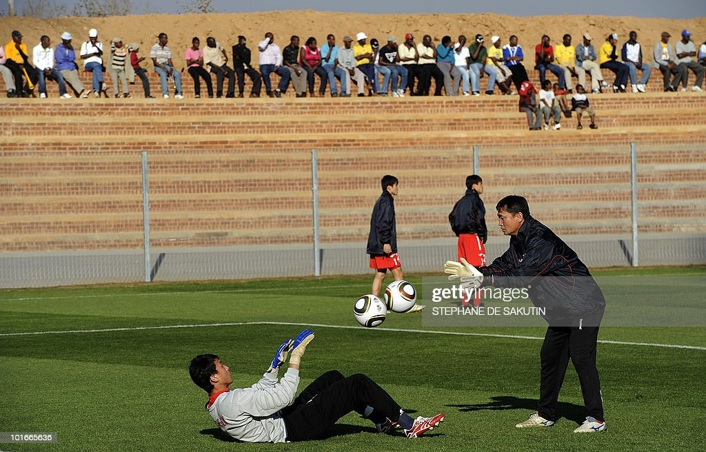 North Korea's goalkeeper Ri Myiong-Guk (L) warms up with a team mate during a training session prior an international friendly football match against Nigeria at Makhulong stadium on June 6, 2010 in Tembisa . The 2010 FIFA World Cup football championship is due to take place in South Africa from June 11 to July 11 of 2010.