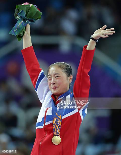 North Korea's gold medalist Kim Un-Hyang cries during the victory ceremony in the Women's Apparatus Final during the 2014 Asian Games at Namdong...
