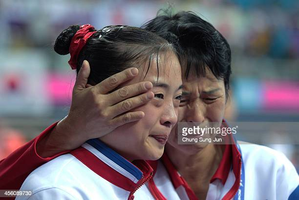 North Korea's gold medalist Kim Un-Hyang cries in the Women's Apparatus Final during the 2014 Asian Games at Namdong Gymnasium on September 25, 2014...