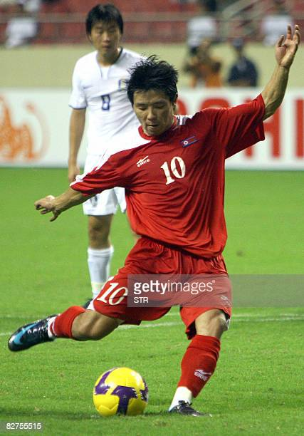 North Korea's Hong Yongjo takes a shot at goal during the World Cup 2010 qualifier soccer match against South Korea at Shanghai Hongkou Football...