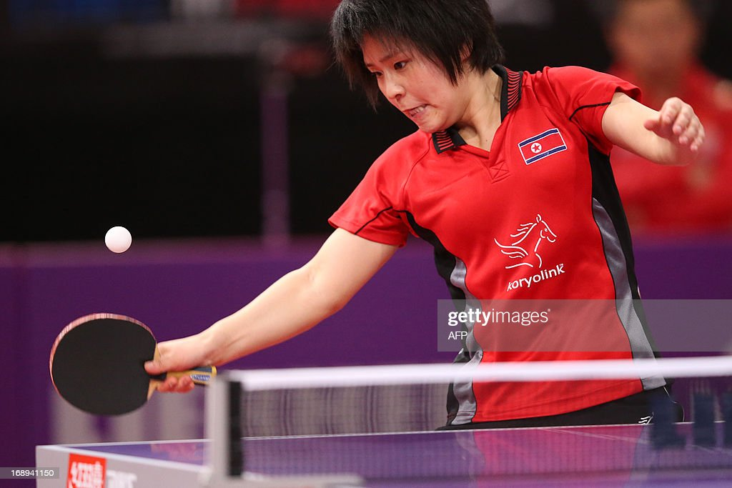 North Korea's Hye Song Kim plays against China's Yang Wu on May 17, 2013 in Paris, during the fourth round of Women's Singles of the World Table Tennis Championships.