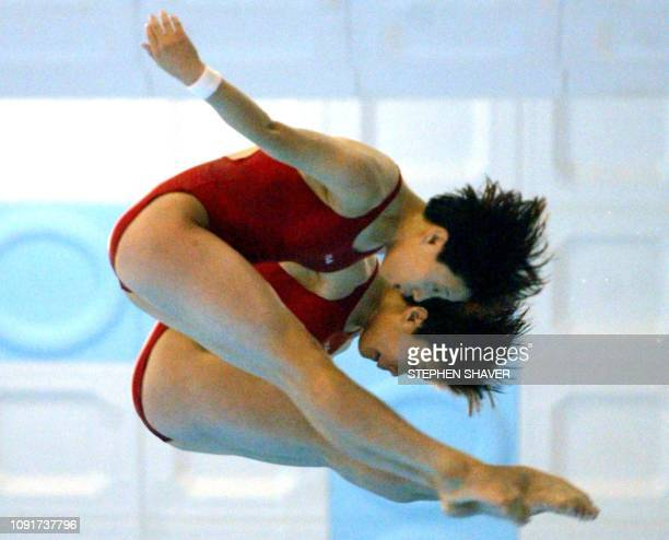 North Korea's Jon HyonJu and Kim KyongJu perform their dive routine during the women's synchronized diving finals 09 October 2002 at the 14th Asian...