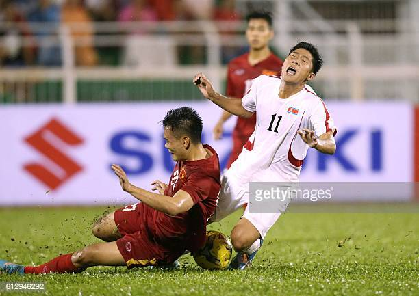 North Korea's Jong Il Gwan fights for the ball with Vietnam's Luong Xuan Truong during a friendly match in Ho Chi Minh City on October 6 2016 Vietnam...