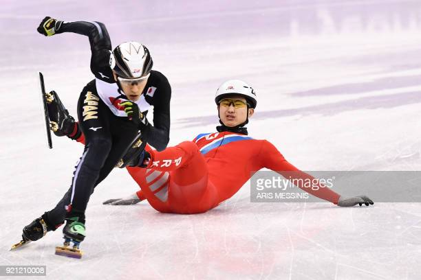 North Korea's Jong Kwang Bom crashes in the men's 500m short track speed skating heat event during the Pyeongchang 2018 Winter Olympic Games, at the...
