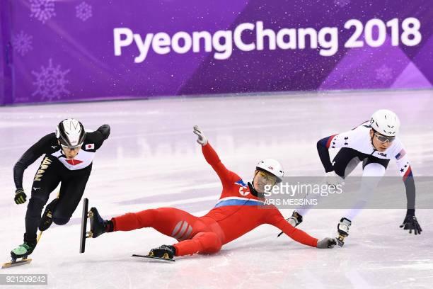 North Korea's Jong Kwang Bom falls as Japan's Keita Watanabe and USA's Thomas Hong maneuver past in the men's 500m short track speed skating heat...