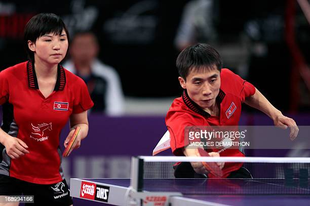 North Korea's Kim Hyok Bong and Kim Jong compete against South Korea's Lee Sangsu and Park Youngsook in the Final match of the mixed doubles of the...