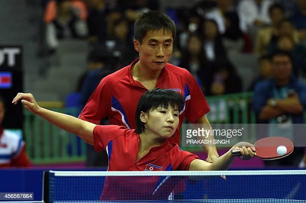 North Korea's Kim Hyokbong and Kim Jong compete against Hong Kong's Jiang Tianyi and Lee Ho Ching during the mixed doubles table tennis final at the...