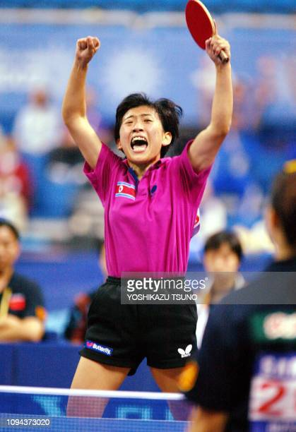 North Korea's Kim Hyon Hui leaps in the air to celabrate her victory against China's Wang Nan during the final of the table tennis women's team event...