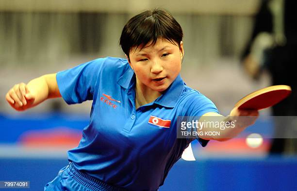 North Korea's Kim Jong returns a shot against China's Wang Nan during the women's preliminaries of the World Team Table Tennis Championship in...