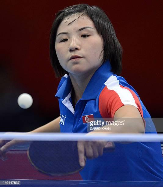 North Korea's Kim Jong returns a shot to Croatia's Cornelia Molnar during a table tennis women's singles preliminary round match of the London 2012...