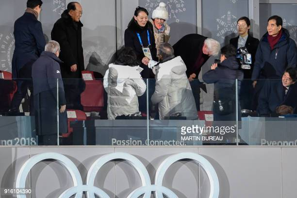 TOPSHOT North Korea's Kim Jong Uns sister Kim Yo Jong shakes hand with South Korea's President Moon Jaein during the opening ceremony of the...