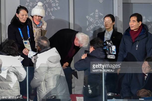 TOPSHOT North Korea's Kim Jong Uns sister Kim Yo Jong shakes hand with South Korea's President Moon Jaein as Japan's President Shinzo Abe looks on...