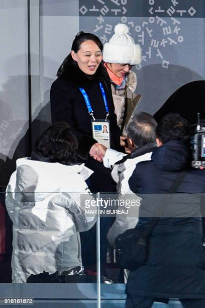 North Korea's Kim Jong Uns sister Kim Yo Jong shakes hand with South Korea's President Moon Jaein during the opening ceremony of the Pyeongchang 2018...