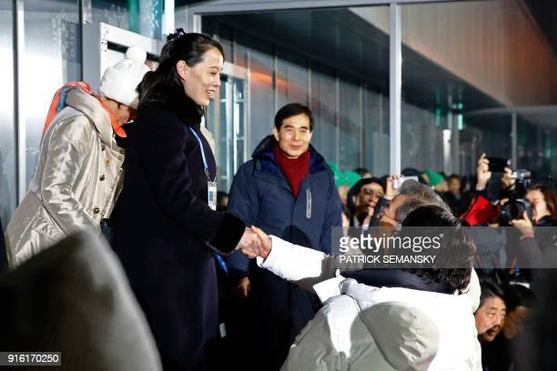 TOPSHOT North Korea's Kim Jong Un's sister Kim Yo Jong shakes hands with South Korea's President Moon Jaein during the opening ceremony of the...