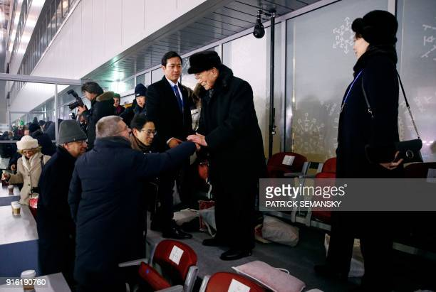 TOPSHOT North Korea's Kim Jong Un's sister Kim Yo Jong watches as North Korea's ceremonial head of state Kim Yong Nam shakes hands with President of...